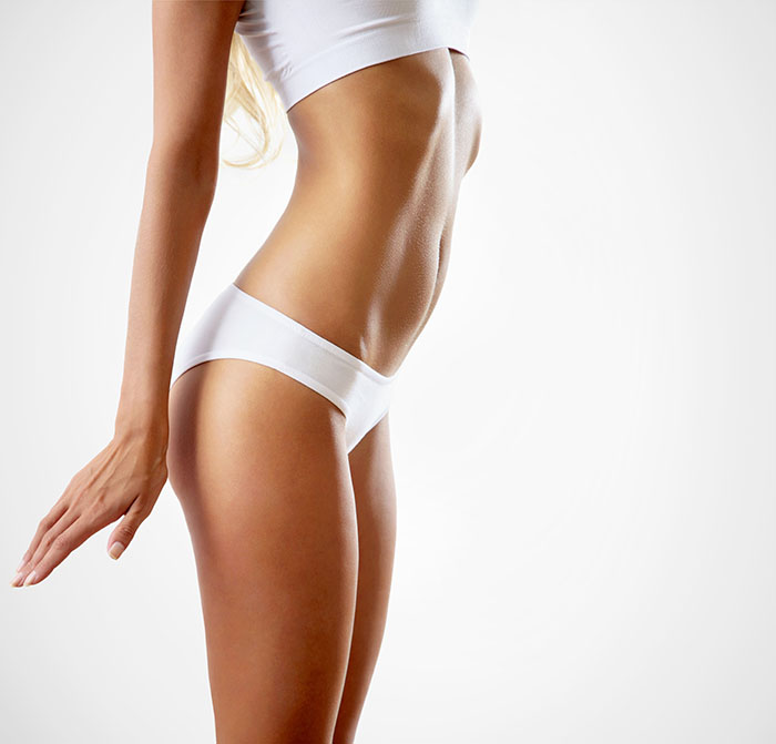 Woman showing of slim and toned body | LipoLaser of South Jersey