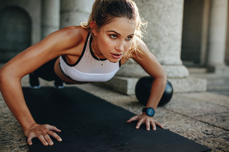Woman working out at home gym